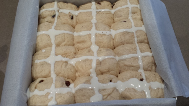 Buns with crosses ready for baking