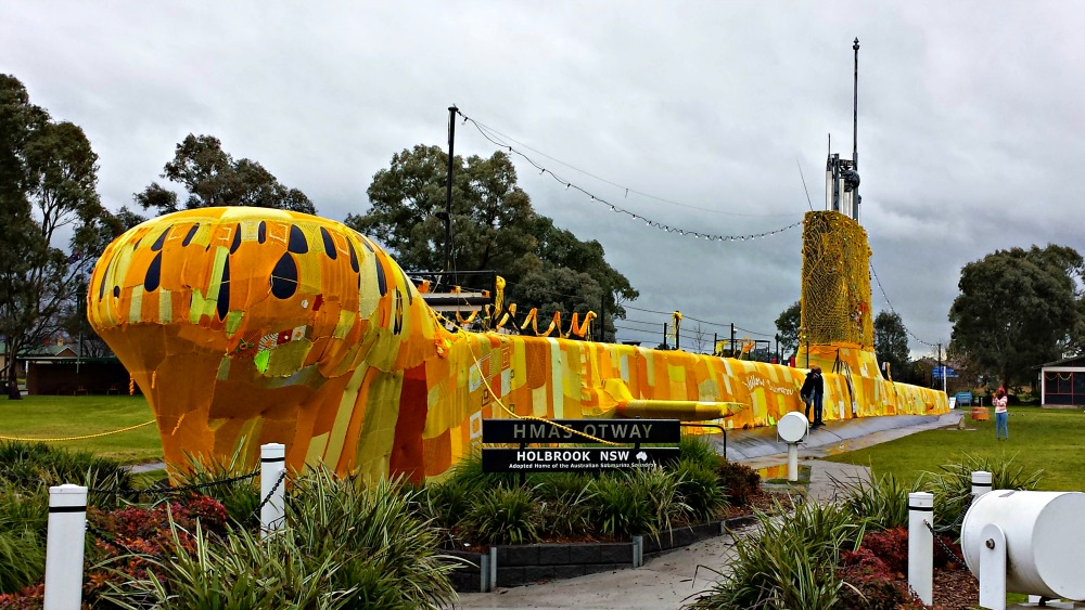 HMAS Otway covered in yellow crochet squares