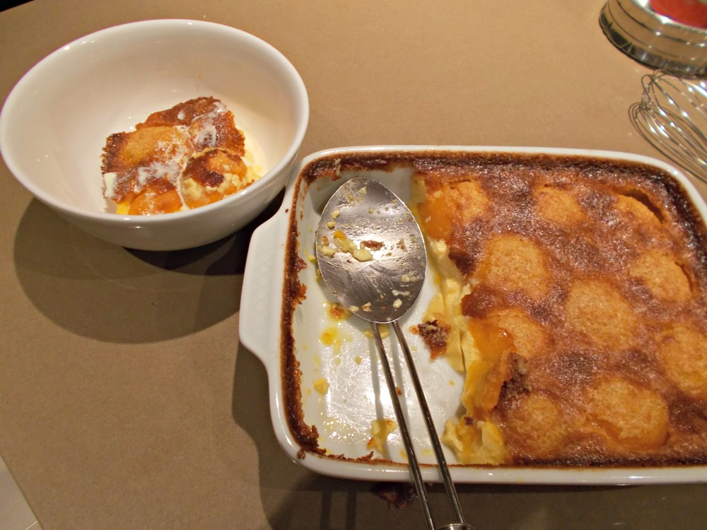 The baked apricot clafoutis served with a drizzle of cream.