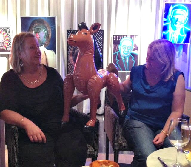 Anne Gracie with Cathryn Hein admiring Hot Chocolate the blow-up horse in the QT bar at ARRC 2015