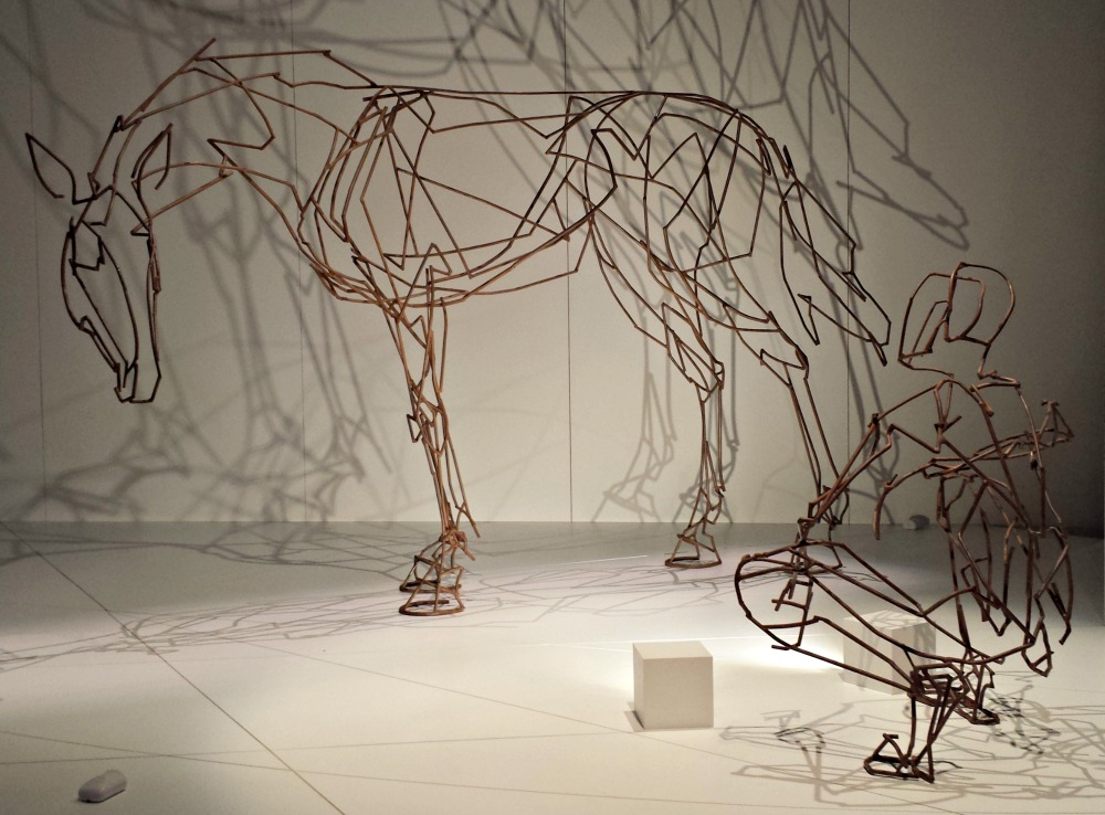 Wire man and horse sculpture