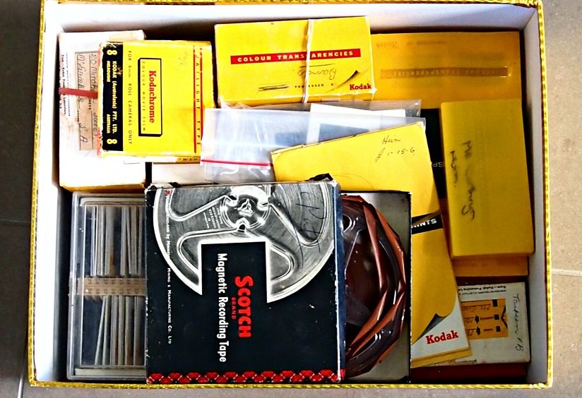 Box of slides and its mystery film.
