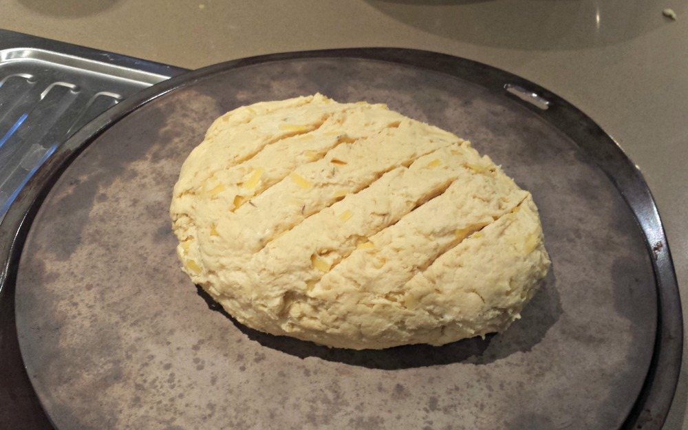 Dough with slashes in the top, ready for baking.