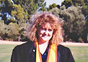 Me at uni graduation with big hair