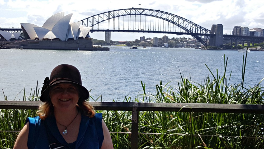 Cathryn Hein at Sydney Harbour with the bridge and Opera House in the background