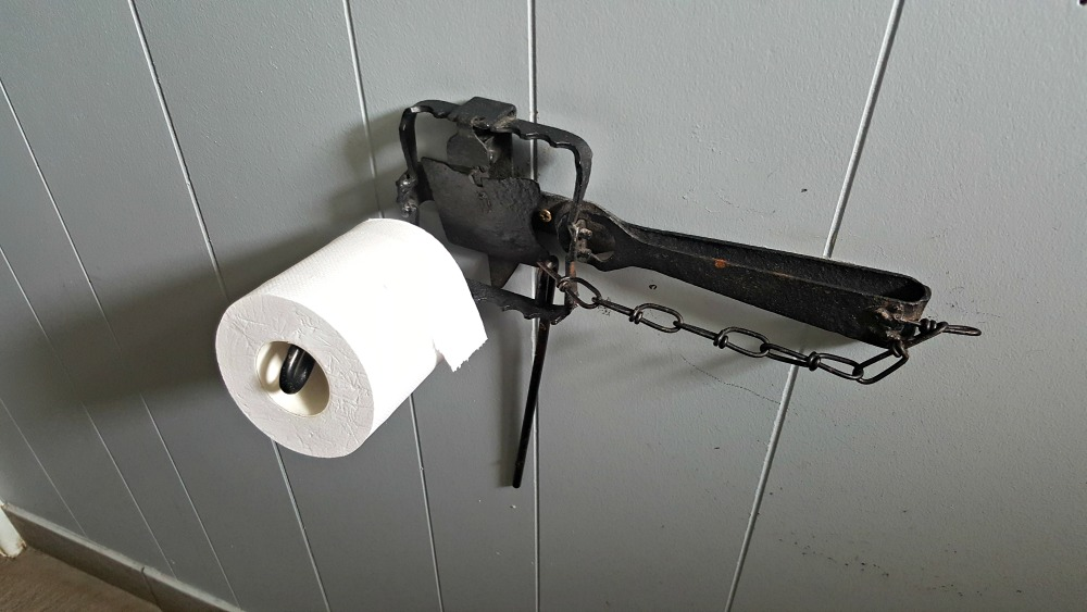 One of the loo roll holders made from old rabbit traps.