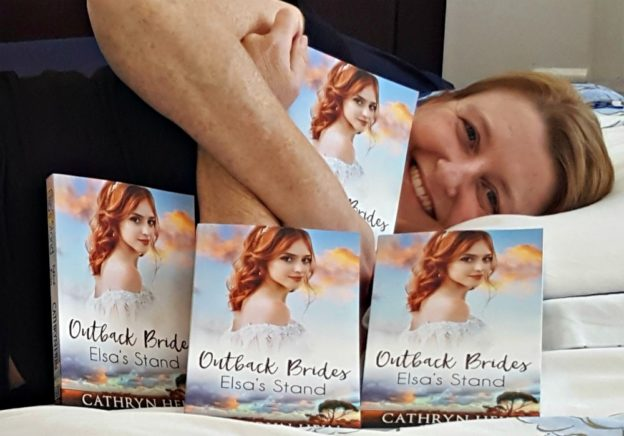 Cathryn cuddling copies of Elsa's Stand