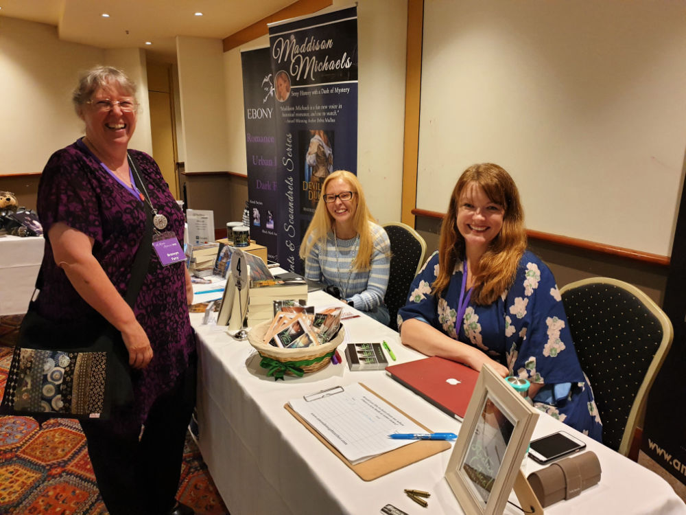 Authors Maddison Micheals, Amanda Knight and (standing) Bronwyn Parry at ARR19, Sydney.