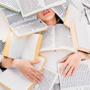 Woman buried under books
